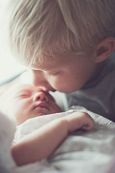 sibling kisses. newborn photo