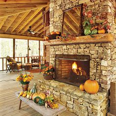 Autumnal Fireplace - Fall's Best Outdoor Rooms - Southern Living fall mantels, covered decks, decorating ideas, outdoor space, outdoor room, back porches, outdoor fireplaces, stone fireplaces, screened porches