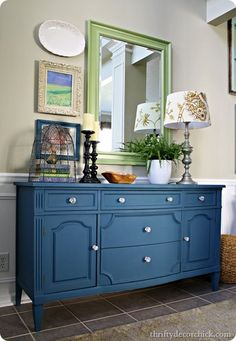 Thirfty Decor Chick blog dresser makeover from black to Annie Sloan Aubusson Blue. So pretty.  Love the blue for the front living room
