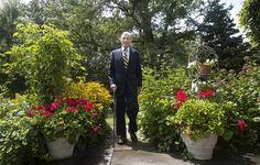 Former U.S. Sen. John Warner stands in the garden of his home in Alexandria, Va. in August. (Photo by Kaitlin McKeown / Daily Press)