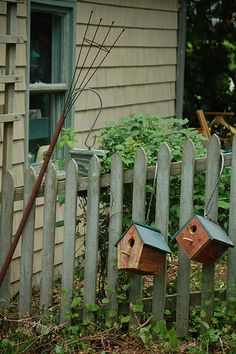 Picket Fence And Birdhouses.