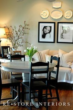 Distressed round timber breakfast table and black painted chairs