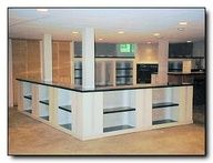 Basement idea of airiness and use of space between pillars