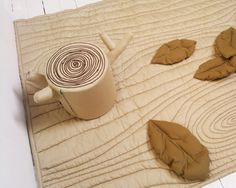 Woodgrain quilt + tree stump pillow. Cute DIY gift idea for babies.