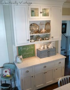 Love the old glass and silver in these open kitchen cabinets eclecticallyvintage.com