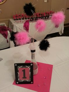 Feather Pom Pom Centerpiece...A beautiful young lady wanted feather centerpieces, but the expense was too much.  Her mom asked if there was anything I could come up with within her budget using a balloon centerpiece idea she saw from another design I made.  Feather Boa Pom Poms were the perfect fit, both theme and budget wise...AND THEY WERE A HIT!!!!  You DON'T have to pay a lot to get what you want...sometimes, you can be better, AND unique!