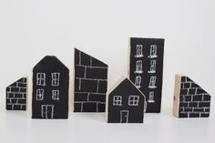DIY chalkboard city blocks. I see a can of chalkboard spray paint in the near future. #littlenest #pinparty