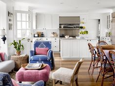This blue-and-white living room would be plain-ole pretty on its own. But it's a head-turner with pops of pink such as the fuchsia ottoman and dusty rose throw pillows.