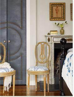 Novel idea of an upholstered closet door with nail head trim.