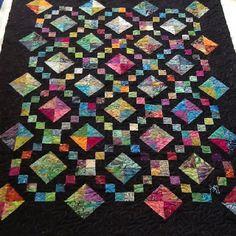 Batik Buckeye Beauty done with variegated thread