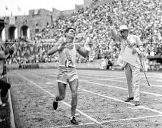 Juan Carlos Zabala, a 20-year-old newsboy from Argentina, crosses the finish line to win the 1932 Olympic marathon at the Los Angeles Memorial Coliseum