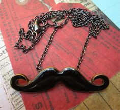 BLACK ENAMEL MUSTACHE necklace. $19.50.  Love this.  http://www.etsy.com/listing/128770274/black-enamel-mustache?ref=shop_home_active