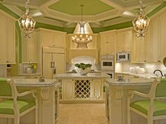 Round apple green kitchen. Love the ceiling!