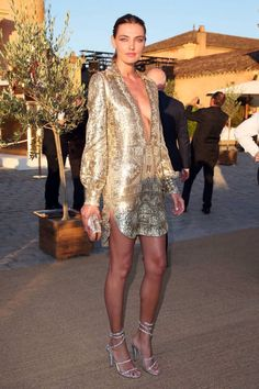 gold tunic, not for the faint of heart ... via They All Hate Us
