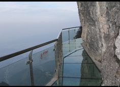 Terrifying Glass Skywalk on the Side of Tianmen Mountain, Hunan Province, China. Cliff is 1,430 meters high! Would YOU do it?
