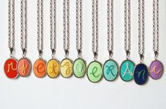 Colorful initial necklaces, hand-embroidered by The Merriweather Council via EmmalineBride.com.