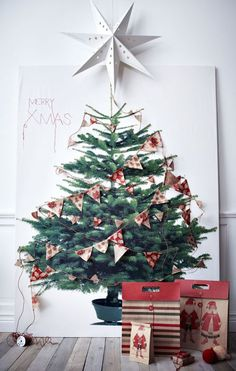 Alternative Christmas tree ideas, poster print on wall with paper decorations