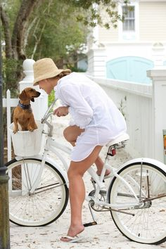 ♂ lady with her dog in white white bicycle white sand beach road