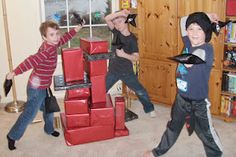 """two teams build separate towers out of """"blocks"""" and try to knock the opposite teams down with """"stuffed ninja stars"""""""