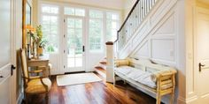 bright entry way with bench and chair for removing shoes