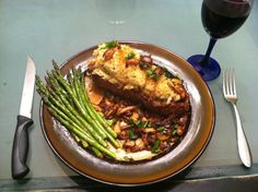 Crab crusted NY Strip in a wild mushroom dry sherry reduction sauce.