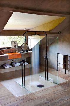 Unique overhead shower incased in glass