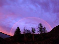 Photo: Rainbow in purple sky