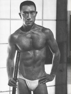 Author Yukio Mishima photographed by Tamotsu Yatō. Oh my, maybe I should read something of his!