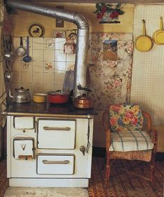 A very rustic and rural French farmhouse kitchen with stove