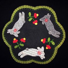Handmade candle mats....can buy pattern and wool fabric to make designs. Wonderful DIY project!