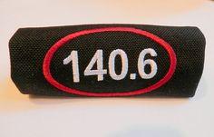 140.6 Ironman triathlon luggage handle wrap by HandleWraps on Etsy, $10.00