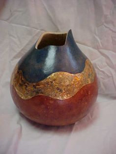 Michelle Hinson always impresses everyone with her decorative gourds. You can make one like this at Leisure Craft Camp in September 2012.