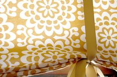 """No-sew Roman shades:  """" I gathered the fabric, making soft folds (you could hold them in place with binder clips). Then I looped ribbon over the top and tied into bows along the bottom. Easy peasy!""""  {Making It Lovely}"""