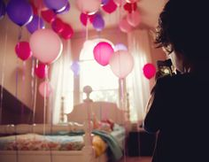 I love the idea of waiting til your little one is asleep & then inflating several balloons with helium, attaching curled ribbon streamers to each & then letting them go through the door quietly. When the birthday child wakes up, Voila!   They start their day very happily! :)