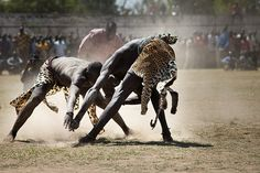 Juba, Sudan: Two Sudanese wrestlers fight at a stadium during the final of Sudan's first commercial wrestling league between the Mundari tribe from Central Equatoria and the Dinka from Bor
