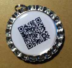 QR Code Bottle Cap Pet I.D. Tag (with front and back). $7.00, via Etsy.