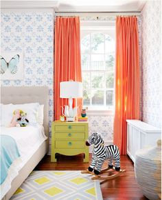 pretty prints and bold drapes; very rustic but also childish, great for a little girls room