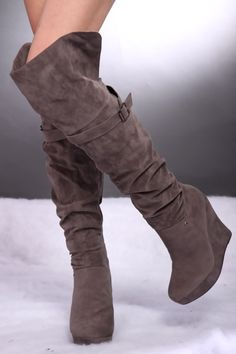 Love the wedge boots especially this are knee high...tall people pull it off better