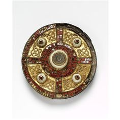 Disc brooch  Place of origin: Kent, England (probably, made)  Date: 600-700 (made)  Artist/Maker: unknown (production)  Materials and Techniques: Silver, bronze, gold, garnet, shell