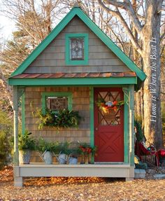 Darling garden shed decorated for the holidays - so cute!