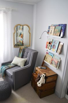 Great nook for reading! Also, love the stacked vintage suitcases in place of a side table - #nursery