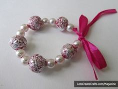 DIY beads from aluminium foil. Mix with small beads and thread onto ribbon - pretty!