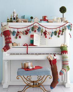 {hat/mitten garland on a piano}