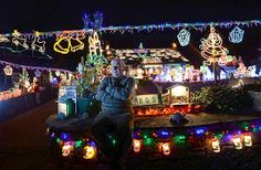 Image: Eric Marshall, who spends three weeks each year setting up his Christmas lights at his home in Bagby, northern England, poses for the...