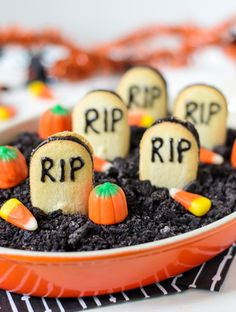 Graveyard-Chocolate-Cheesecake-Dip-for-Halloween---Brownie-cheesecake-dip-with-Oreo-dirt-and-cookie-tombstones.