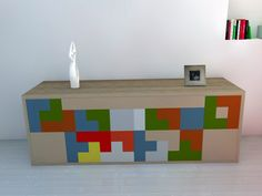 Originally designed by Russia-based Alexey Pajitnov, the Tetris game has enchanted many people over the years since its creation in 1984. By manipulating r -- The tan sections pull out to create a table and seats for two.  The colored sections are drawers. -- I'd love to have a piece like this for the sitting area of my master suite.