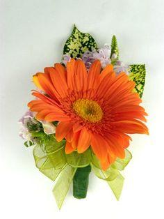 Orange gerbera daisy boutonniere  My favorite flower! A must have in my wedding!
