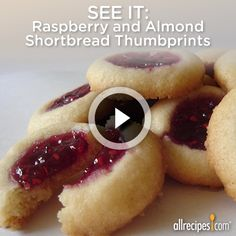 See how it's made: Raspberry and Almond Thumbprints | Your favorite thumbprint cookies, jazzed up with delicious glaze. Repin the holiday classic!