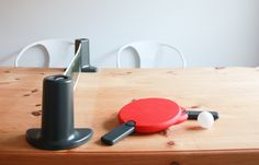 Turn any table into a table tennis court with this portable ping pong set! Great gift idea.
