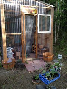 Our greenhouse, earlier this week in May 2012. I built it last year and am actually pretty proud of how it turned out.